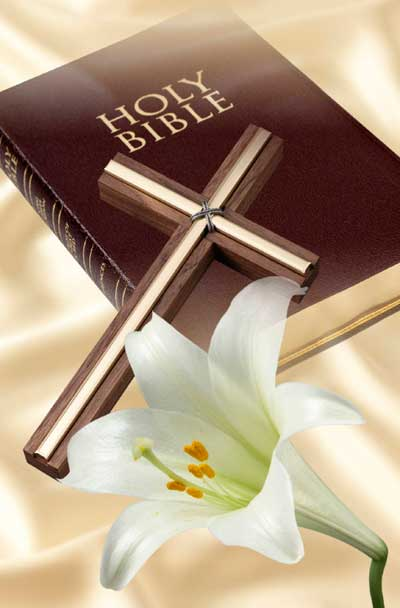 Bible with Cross and Easter Lily laying on top.
