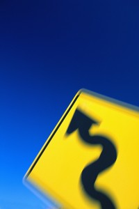 Blurred Winding Road Sign
